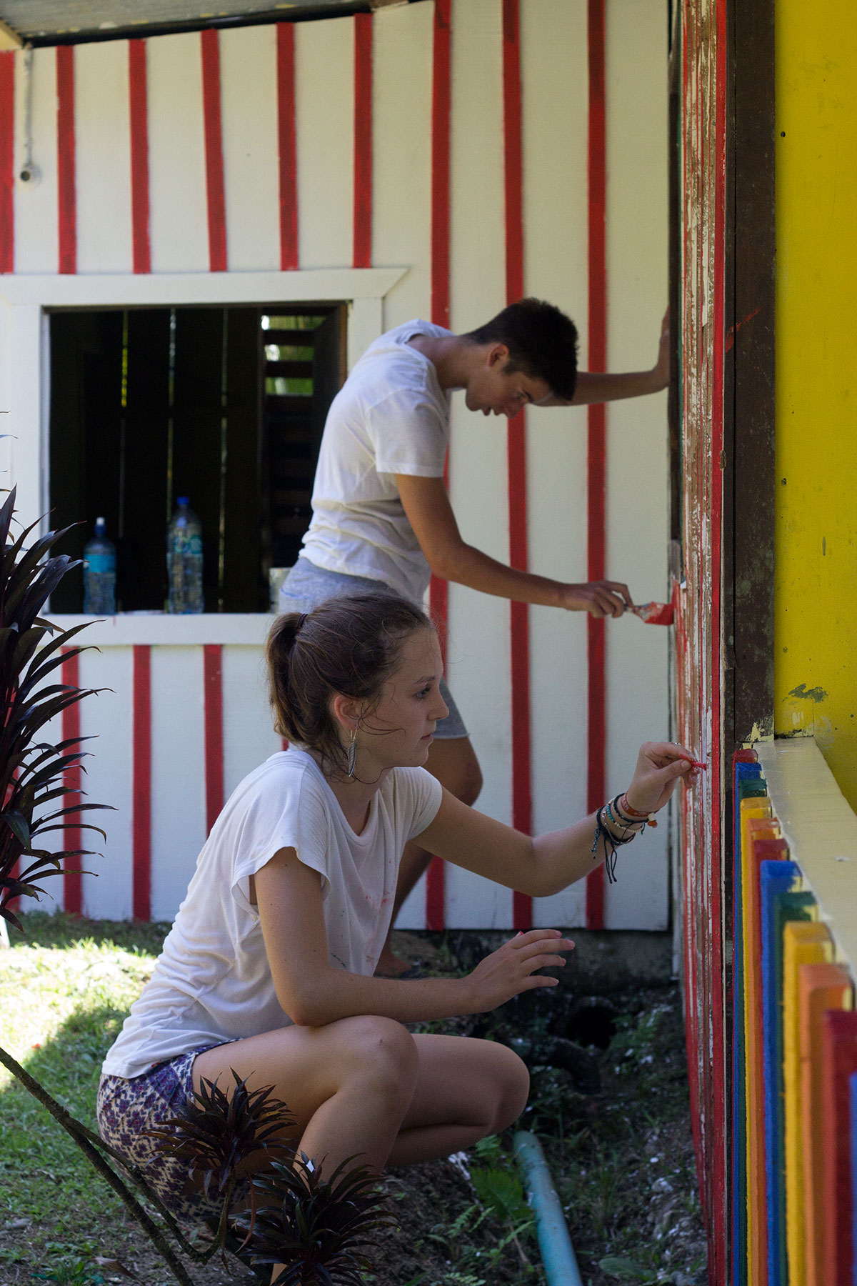 Volunteers Painting the House