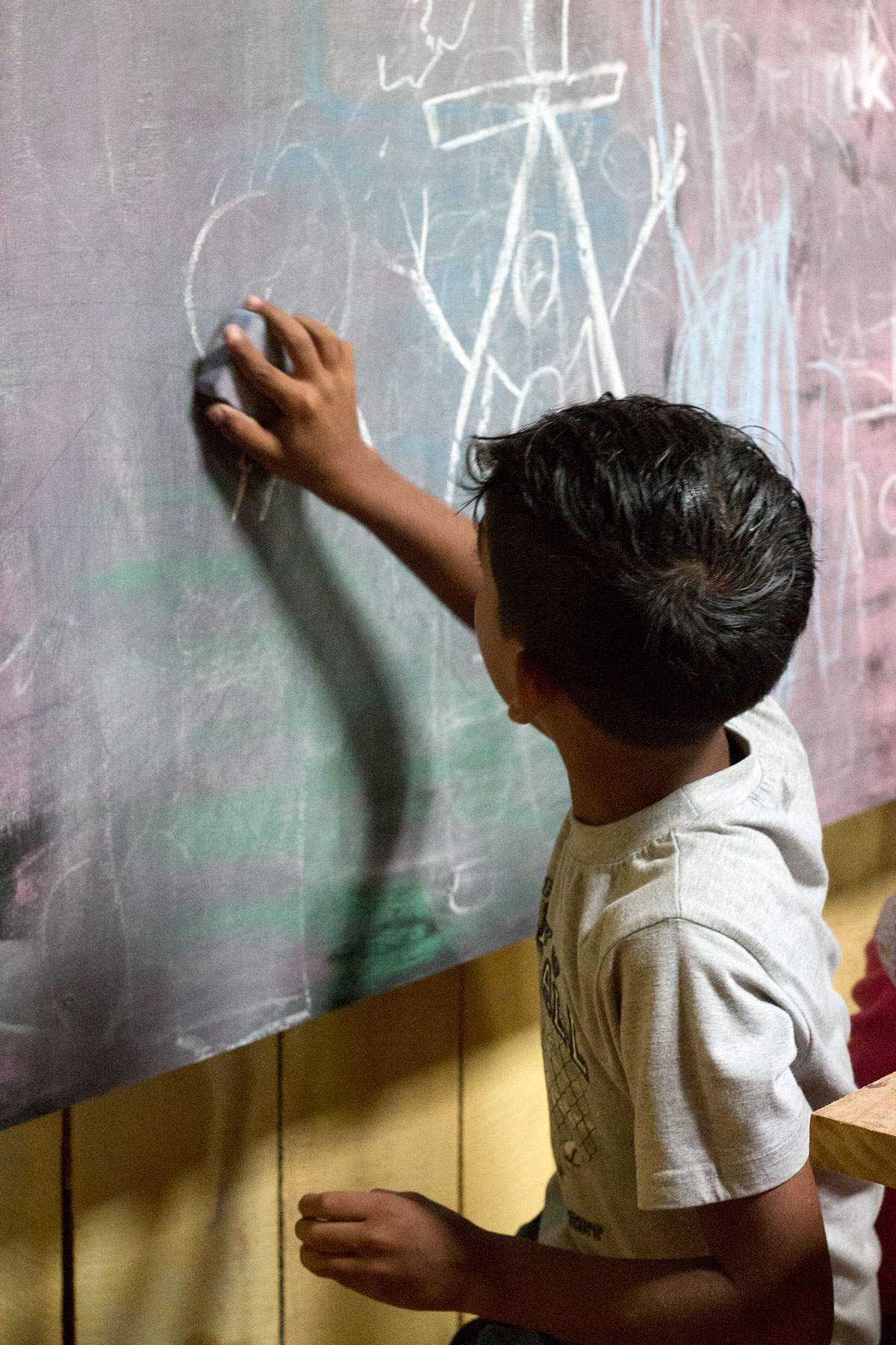 Child Drawing on the Board